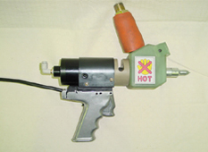 Hand gun for hot butyl